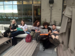 J+D SXSW scholarship winners have an editorial meeting on the roof of the JW Marriott